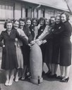 Kirkby factory workers around a bomb, black-and-white photograph, Great Britain, unknown date [between 1939 and 1945], unknown photographer; source: National Museums Liverpool, http://www.liverpoolmuseums.org.uk/nof/blitz/0700_info.html.