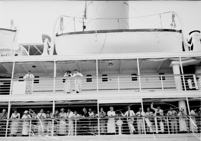 Passenger ship leaving the Dutch East Indies, black and white photograph, between 1920 and 1938, photographer: Christoffel Hendrik Japing; source: Tropenmuseum of the Royal Tropical Institute (KIT) Amsterdam, wikimedia commons, http://commons.wikimedia.org/wiki/File:COLLECTIE_TROPENMUSEUM_Serpentineslingers_bij_het_vertrek_van_een_passagiersschip_Nederlands-Indi%C3%AB_TMnr_10030173.jpg  Creative Commons Attribution-Share Alike 3.0 Unported license.