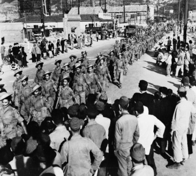 The 2/5th Royal Gurkha Rifles marching through Kure soon after their arrival in Japan as part of the Allied forces of occupation, black-and-white photograph, 1946, unknown photographer; source: Imperial War Museum IND 5209, http://www.iwm.org.uk/collections/item/object/205208269.