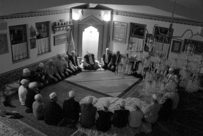 A Zikr Ceremony inside a Bosnian tekke, DATE??, black-and-white photograph, photographer: Nathalie Clayer; source: in privare ownership.